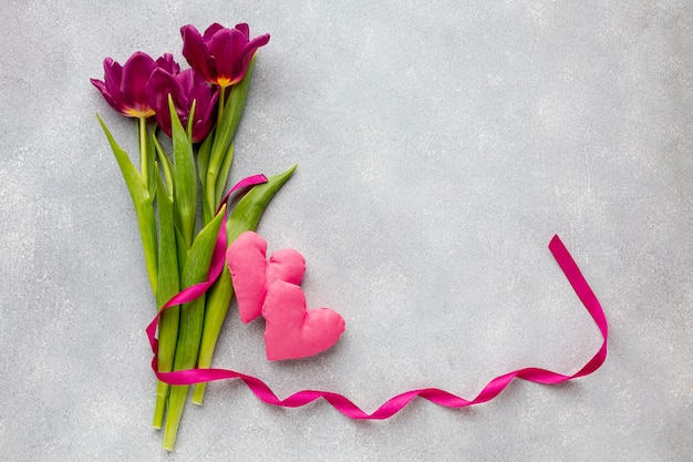 Bouquet of flowers and pink hearts Free Photo