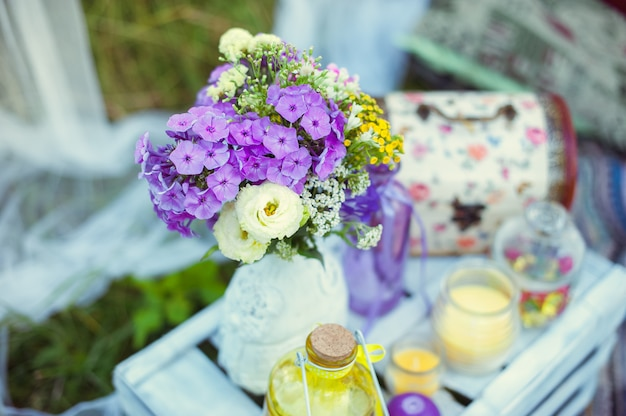 Bouquet of flowers in the style of boho in a glass vase in nature Premium Photo