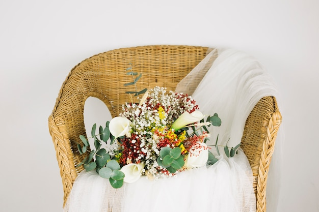 Bouquet of flowers with bridal veil Free Photo