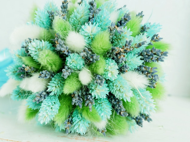 A bouquet of fluffy dried flowers with lavender. Premium Photo