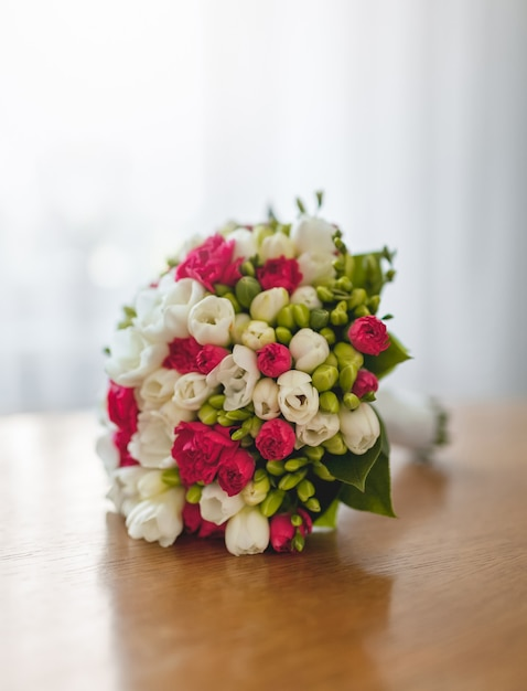 Bouquet of fresh flowers on table Free Photo