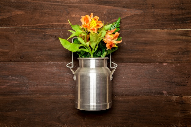Bouquet of lilies in metal water can Free Photo