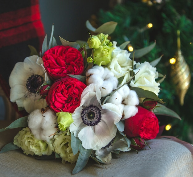 A bouquet of mixed flowers on the furniture. Free Photo