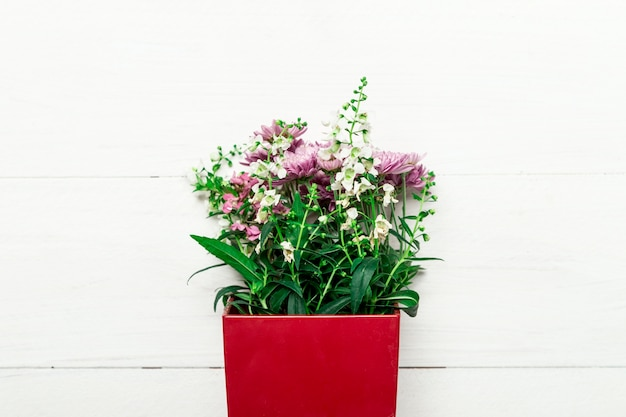 Bouquet of natural flowers in red box Free Photo