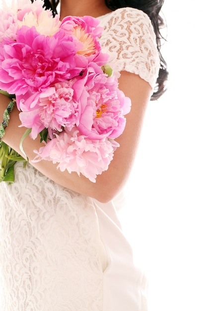 Bouquet of peonies in woman's hands Free Photo