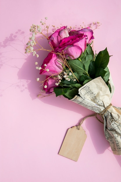 Bouquet of roses wrapped in music sheet Free Photo