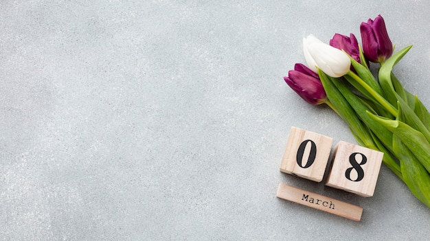 Bouquet of tulips and 8 march lettering with copy space Free Photo