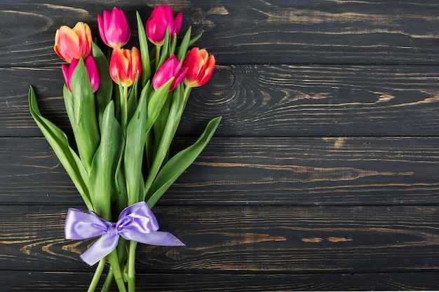 Bouquet of tulips with bow Free Photo
