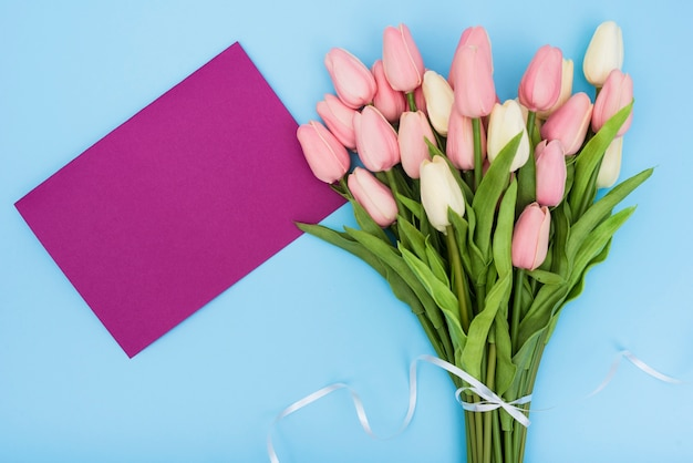 Bouquet of tulips with purple card Free Photo