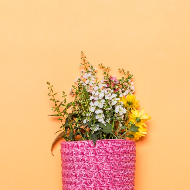 Bouquet of wild flowers in pink bag Free Photo