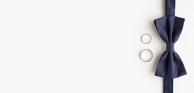 Bow tie and wedding rings copy space Premium Photo