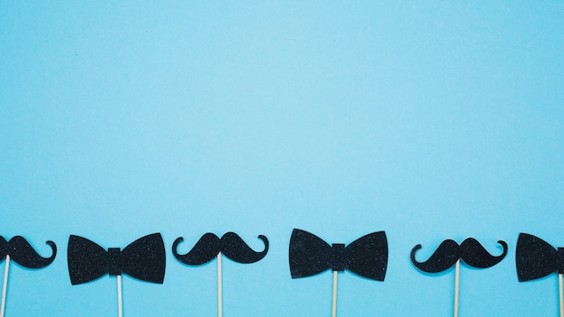 Bow ties and mustaches on wands Free Photo