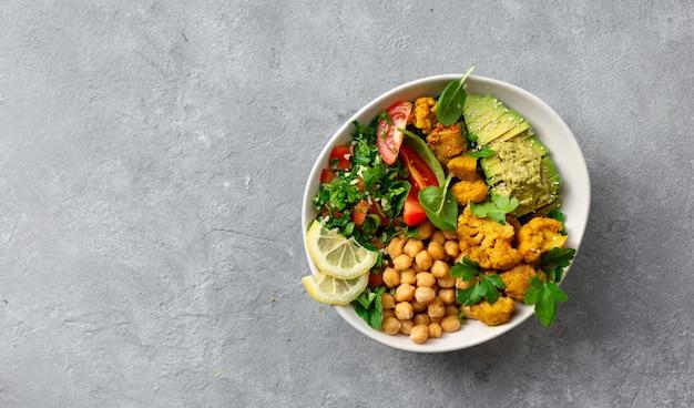 Bowl buddha balanced healthy vegetarian food top view Premium Photo