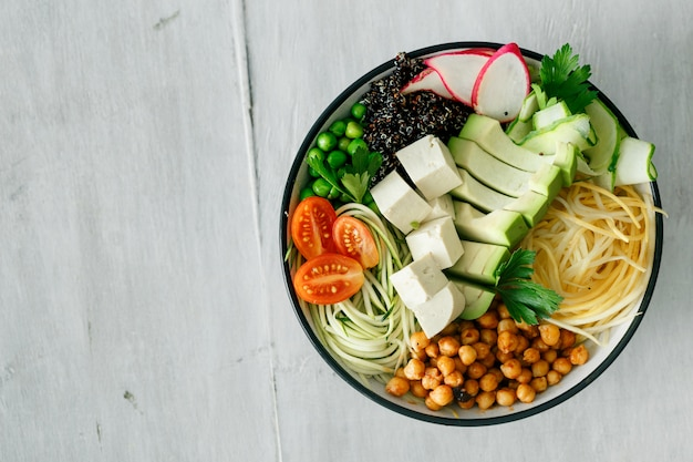 Bowl buddha spiralized vegetables top view healthy food clean eating Premium Photo