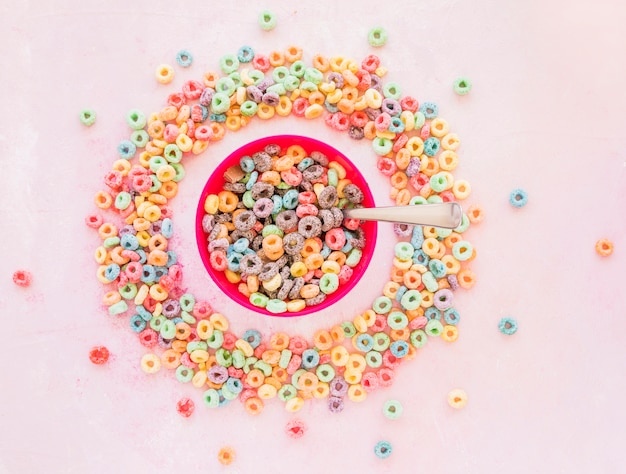 Bowl of cereals in round frame from corn flakes Free Photo