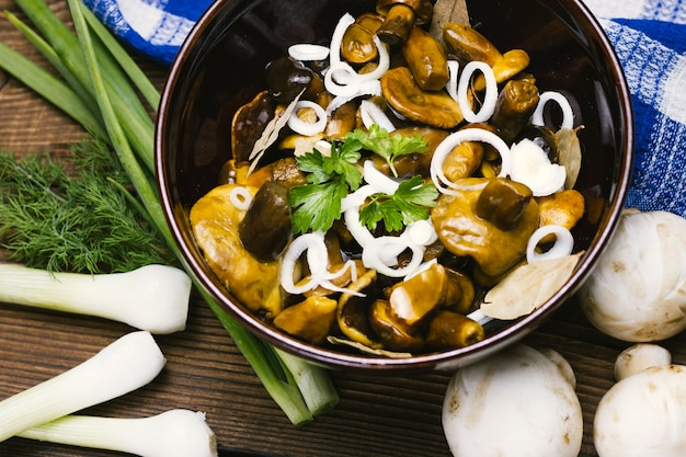 Bowl of cooked mushrooms and onions Free Photo