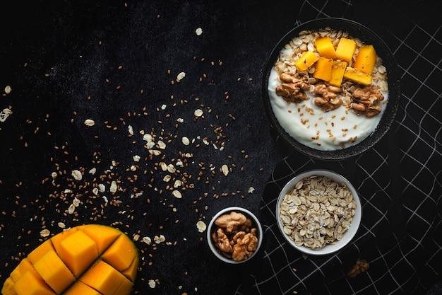 Bowl of homemade granola with yogurt and cereals Premium Photo
