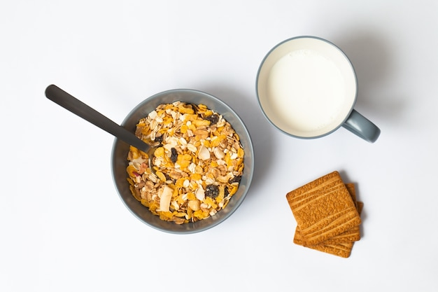 Bowl of cereal, cup of milk and cookies Free Photo