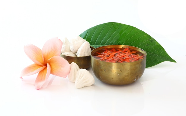 Bowl of water,flower and clay  on white for songkran festival Premium Photo