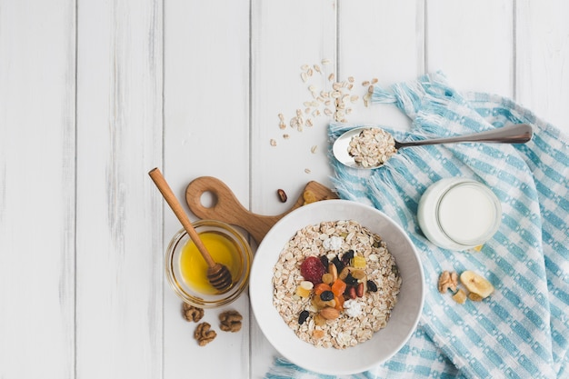 Bowl with muesli near honey Free Photo