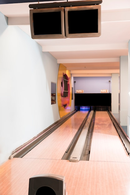 Bowling alley lanes with wooden floor Free Photo