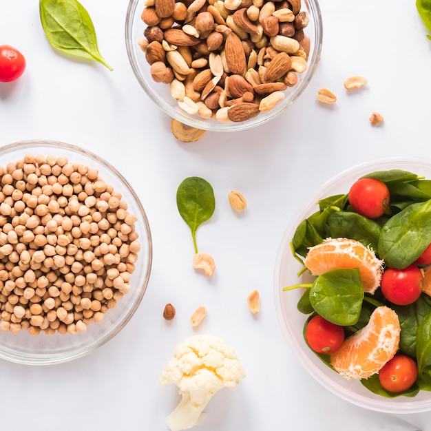 Bowls of healthy ingredients over white background Free Photo