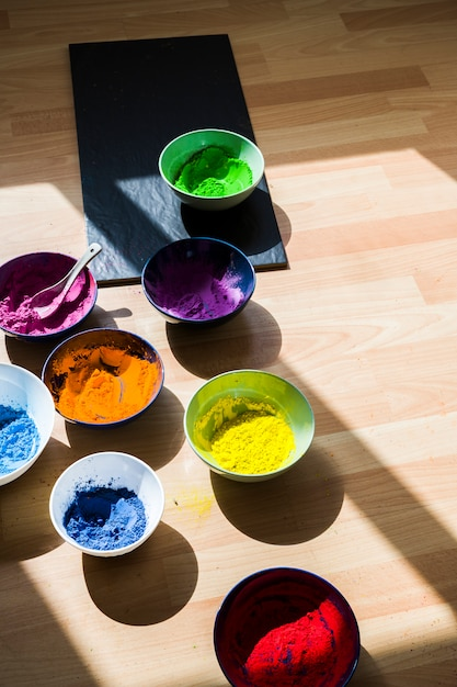 Bowls with bright dry colors on floor Free Photo