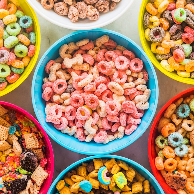 Bowls with different cereals on light table Free Photo