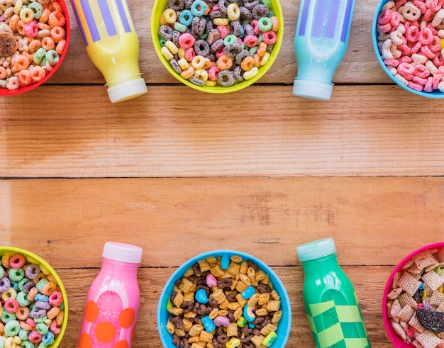Bowls with different cereals and milk bottles Free Photo