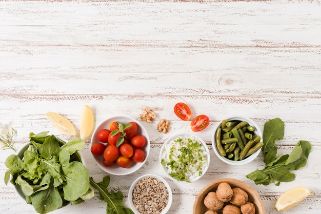 Bowls with healthy food on wooden background Free Photo