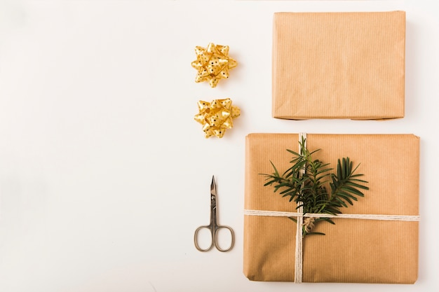 Bows, present boxes in craft papers and scissors Free Photo