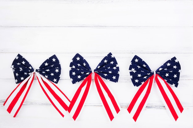 Bows of ribbons with symbols of american flag Free Photo