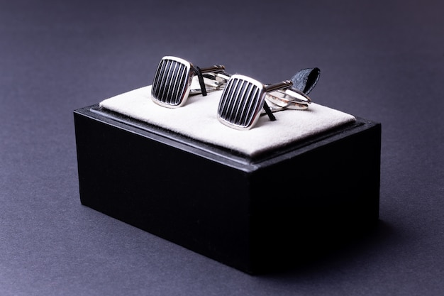 Box with cufflinks for man suit on black Premium Photo