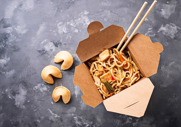 Box with  noodles and fortune cookies Premium Photo