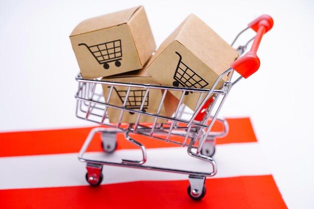 Box with shopping cart logo and austria flag. Premium Photo