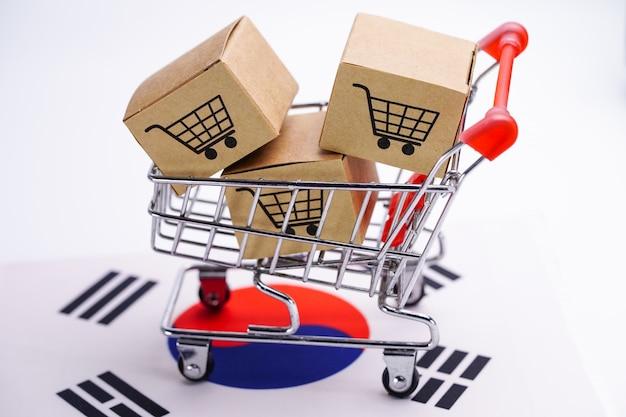Box with shopping cart logo and the korea flag Premium Photo