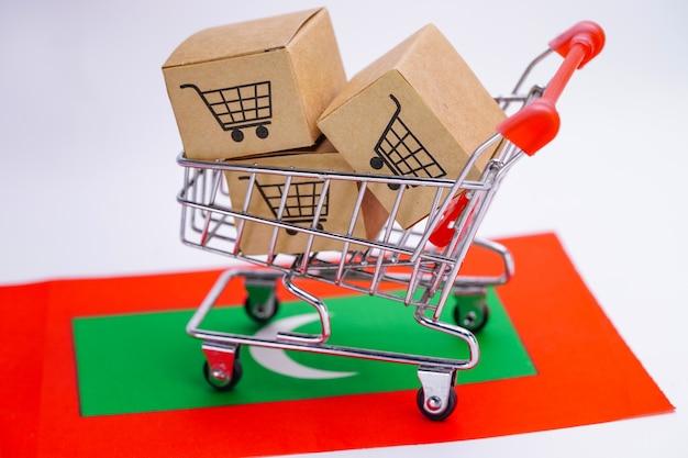 Box with shopping cart logo and maldives flag. Premium Photo