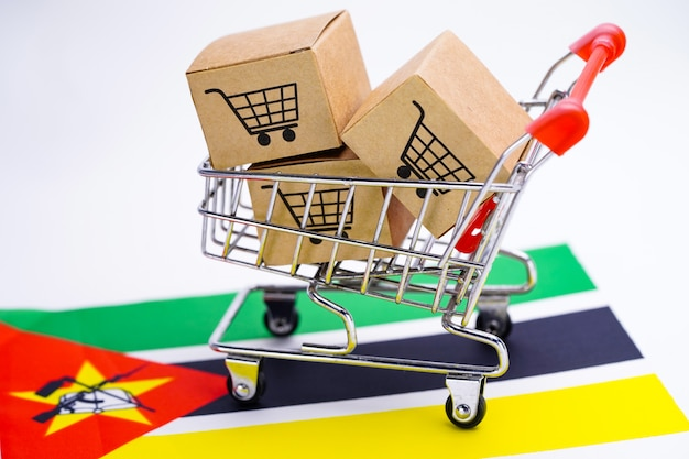 Box with shopping cart logo and mozambique flag Premium Photo