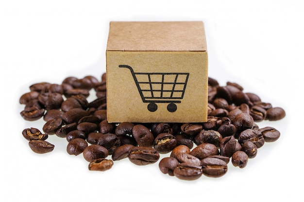 Box with shopping cart logo symbol on coffee beans Premium Photo