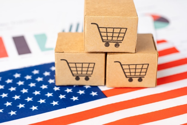 Box with shopping cart logo and usa united state america flag. Premium Photo