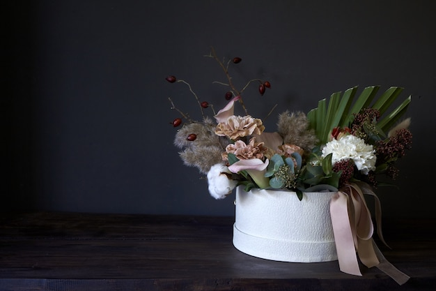 A box with a vintage bouquet on a dark background Premium Photo