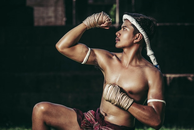 A boxer tied a rope in his hand and performed a fight, the martial arts of muay thai. Free Photo