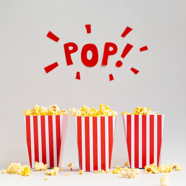 Boxes of popcorn on gray background Free Photo