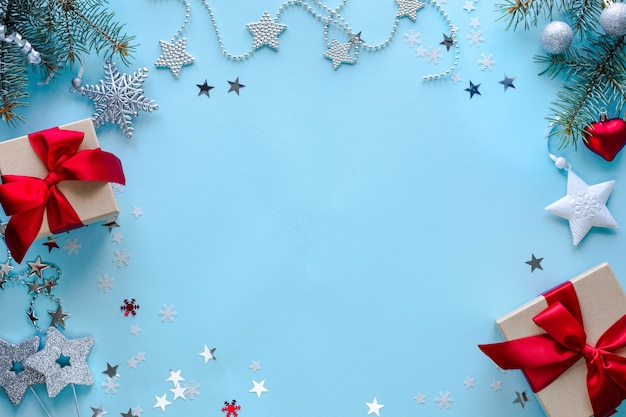 Boxes with gifts and christmas decorations on blue surface Free Photo