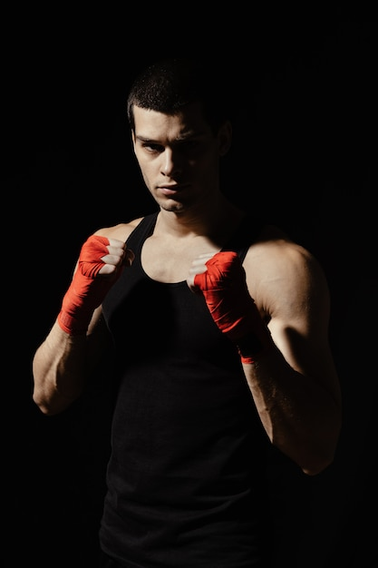 Boxing male standing in a rack Free Photo