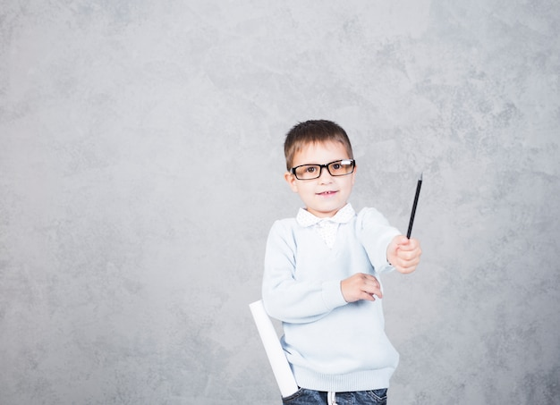 Boy architect with paper roll in pocket smiling Free Photo