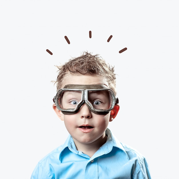 Boy in blue shirt and pilot glasses on light background Premium Photo
