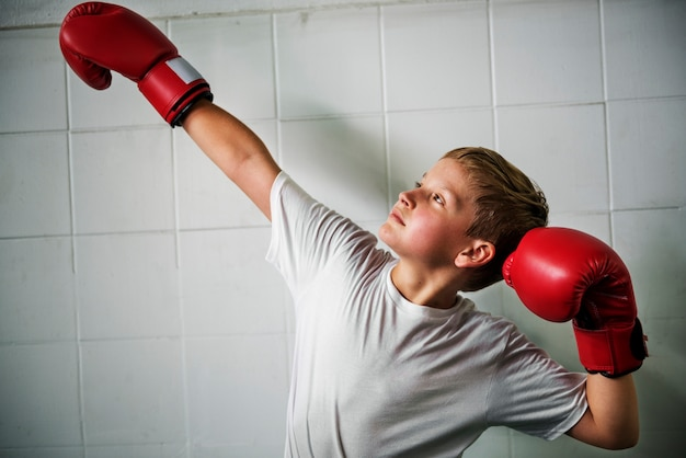 Boy boxing victory confidence posing winning concept Free Photo