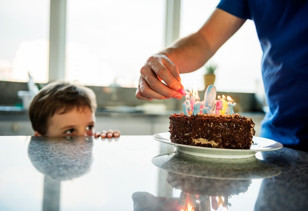 Boy celebrating his birthday with a cake Premium Photo