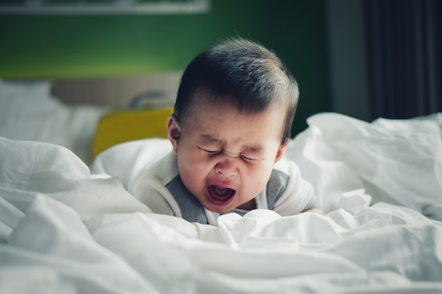 Boy crying because of being in a colic mood. Premium Photo